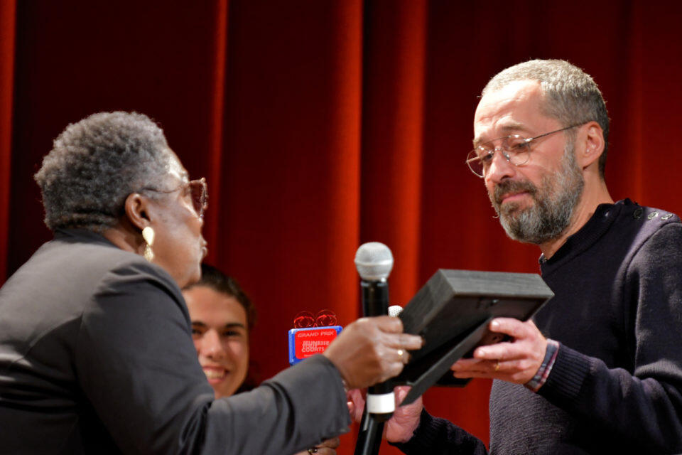 Charles accepting the award at the Rémalard Film Festival